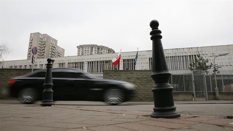 A car drives past a building of the Polish embassy in Moscow [Maxim Shemetov/Reuters]
