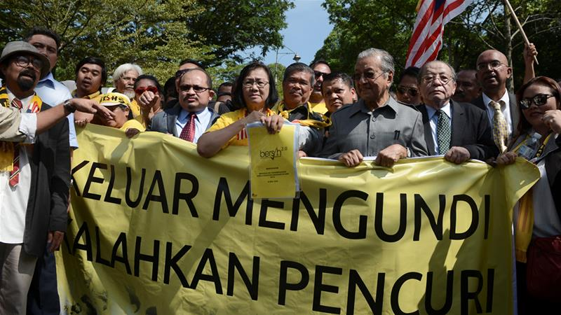 Opposition candidate Mahathir Mohamad and others protest the move to redraw electoral boundaries outside parliament in Kuala Lumpur on Wednesday [Stringer/Reuters]