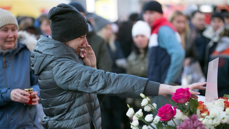 Kemerovo residents seen on March 26 outside the Zimnyaya Vishnya shopping centre where people were killed in a fire on March 25, 2018 [Getty Images]