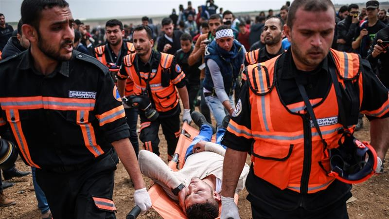 A Palestinian protester wounded by Israeli sniper fire during Land Day protests east of Gaza City [Hosam Salem/Al Jazeera]