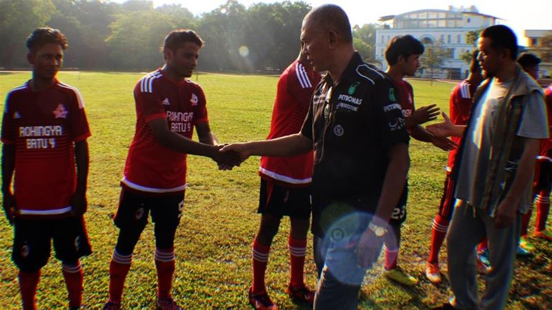 Members of Rohingya Football Club (RFK) in Kuala Lumpur shake hand with club officials - March 30 2018 [Adem S and Omer Faruk Y/Anadolu]