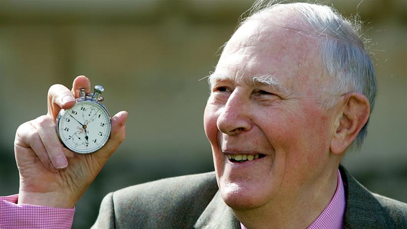 Sir Roger Bannister, who ran the first sub-four-minute mile in 1954, holds the stopwatch used by Harold Abrahams to time the race during 50th anniversary celebrations at Pembroke College, Oxford, May 6, 2004. [Sir Roger was a 25-year-old medical student when he recorded a time of 3 minutes 59.4 seconds for the mile on May 6, 1954.] [Reuters]
