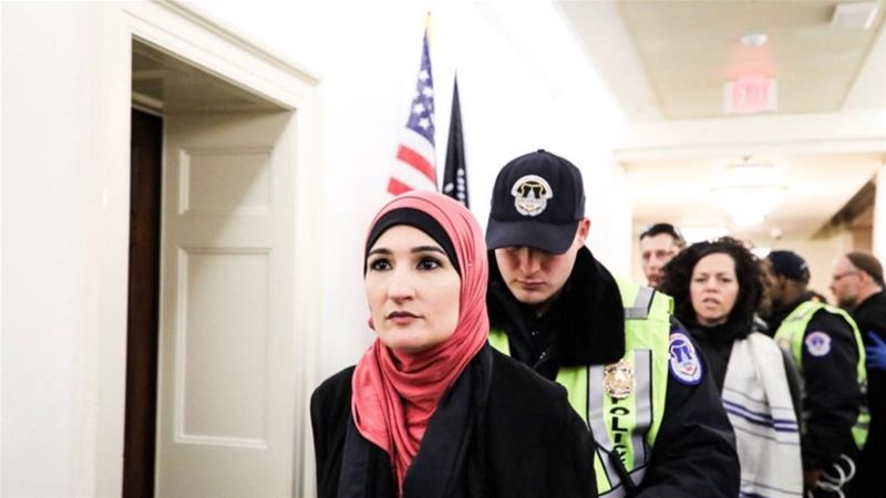 Linda Sarsour seen arrested and led away by police in Capitol Hill, Washington, March 05 2018. [Linda Sarsour/Twitter]