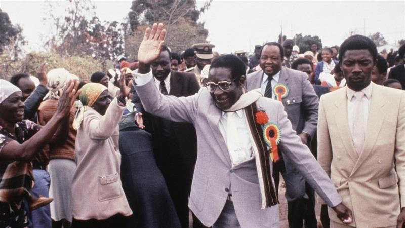 Zimbabwe's Robert Mugabe waves attends an election rally near Harare, in July 1985. His Zanu Party won a landslide victory in the country's first election since independence [File: AP]