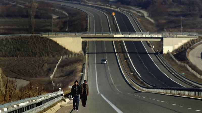 Migrants make their way along the Egnatia Motorway after crossing the Turkish-Greek border [File: Yannis Behrakis/Reuters]
