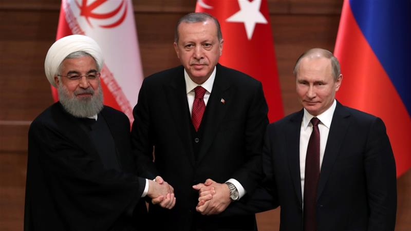 Presidents Hassan Rouhani of Iran, Recep Tayyip Erdogan of Turkey and Vladimir Putin of Russia hold a joint news conference after their meeting in Ankara on April 4 [Reuters/Umit Bektas]