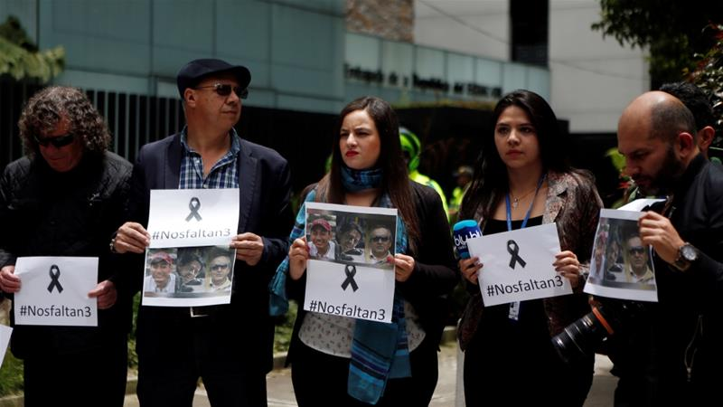 Colombian journalists gather in front of Ecuador's embassy to protest against the murder of journalists and their driver [Jaime Saldarriaga/Reuters]