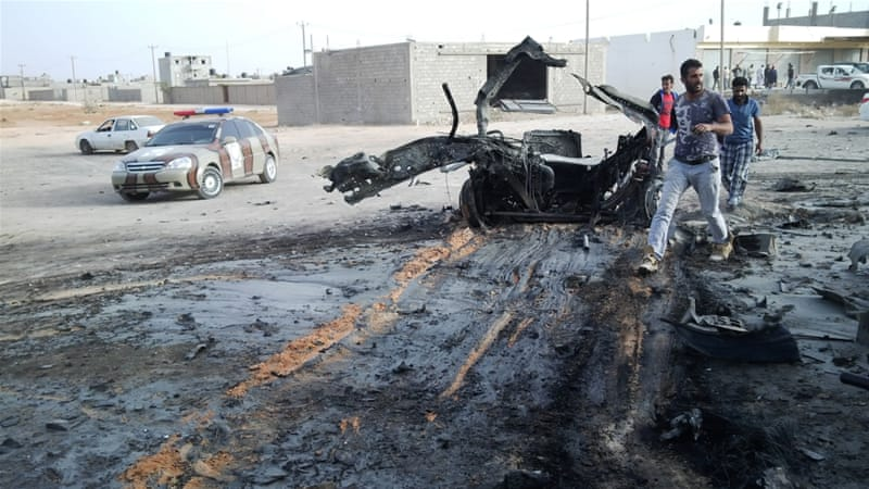 People inspect the site after a car bomb hit the convoy of Abdel-Razeq Nathouri [Reuters]