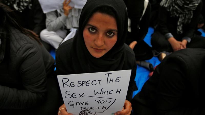 A student in Srinagar protests against the rape of the eight-year-old girl [Danish Ismail/Reuters]