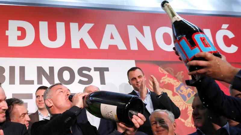 DPS' Milo Djukanovic drinks champagne during celebrations after the presidential vote in Montenegro on April 15, 2018 [Reuters/Marko Djurica]