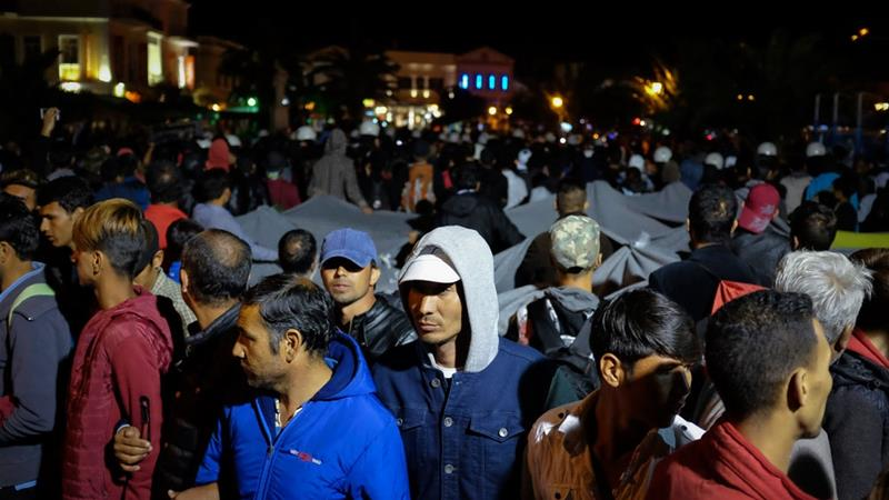 Refugees and migrants had been holding a separate demonstration in the main square of Mytileni when they were attacked [Eurokinissi/AP Photo]