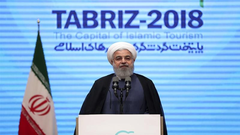 "Rouhani has called on Trump to uphold the nuclear deal or face "" severe consequences"" [Iranian Presidency Office/AP]"