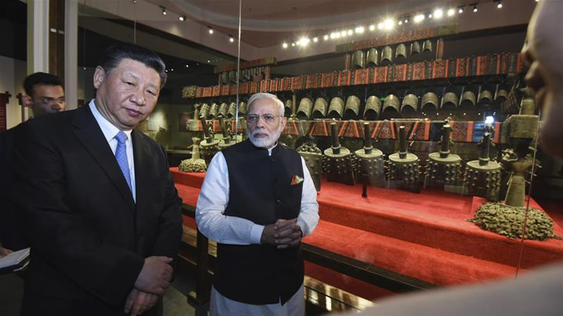 Xi and Modi visit the Hubei Museum on Friday [Indian Ministry of External Affairs via AP]