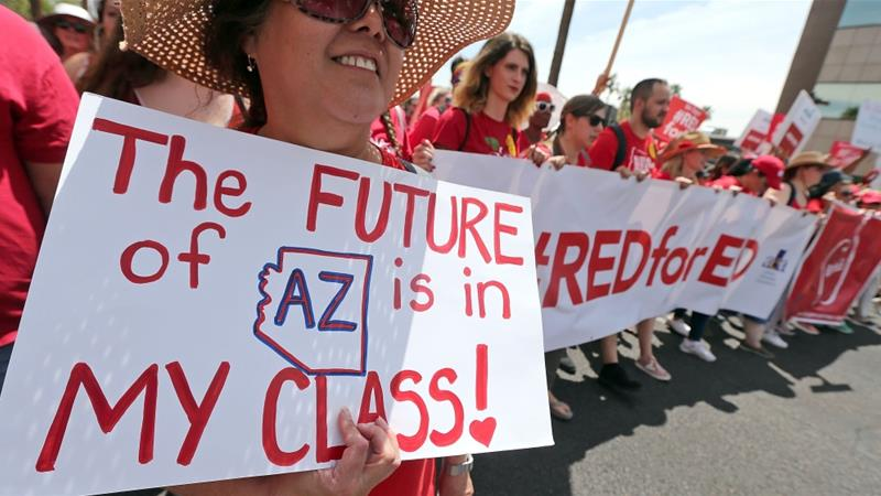 Arizona teachers engaged in their state's first teacher strike in history [Ralph Freso/Getty Images/AFP]