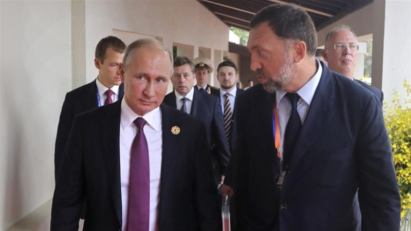 Russian oligarch Oleg Deripaska and Russian president Vladimir Putin [Photo Mikhail Klimentyev/AP]