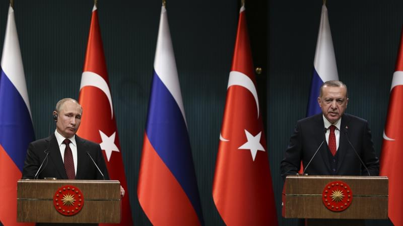 Erdogan, right, said the issue of weapons purchase from Russia 'was now closed' [Anadolu Agency]