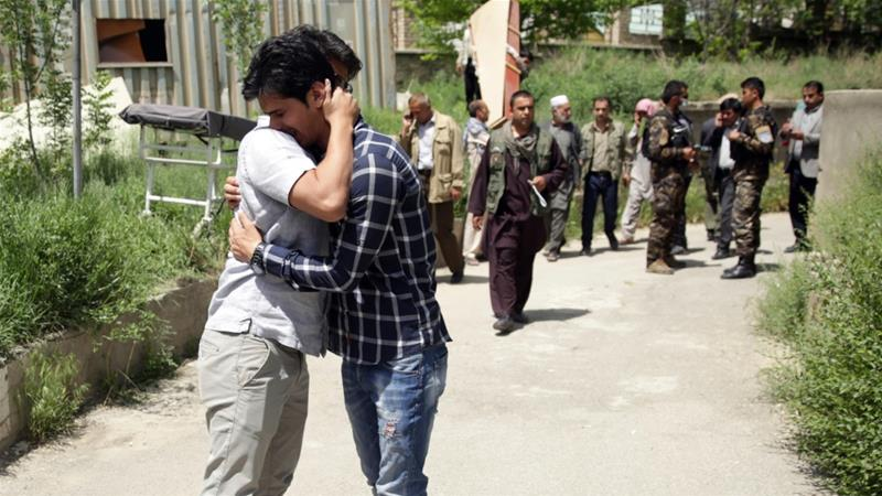 Afghan journalists mourn for their colleagues killed in an April bombing in Kabul [File: Massoud Hossaini/AP Photo]