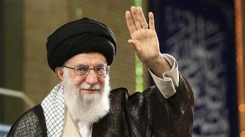 Khamenei waves to a crowd in Tehran on Monday [Office of the Iranian Supreme Leader via AP]
