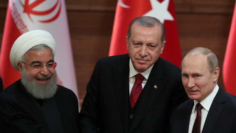 Hassan Rouhani of Iran, Tayyip Erdogan of Turkey and Vladimir Putin of Russia hold a joint news conference after their meeting in Ankara, Turkey April 4, 2018 [Umit Bektas/Reuters]