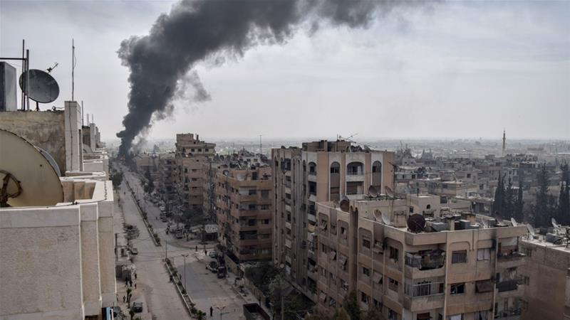 A March 20 picture shows smoke rising in Douma following air raids [Mouneb Abu Taim/ Anadolu Agency]