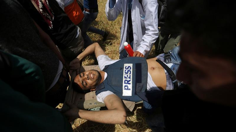 Yaser Murtaja, 30, was shot in the stomach in Khuza'a in the southern Gaza Strip on April 6 [Ibraheem Abu Mustafa/Reuters]