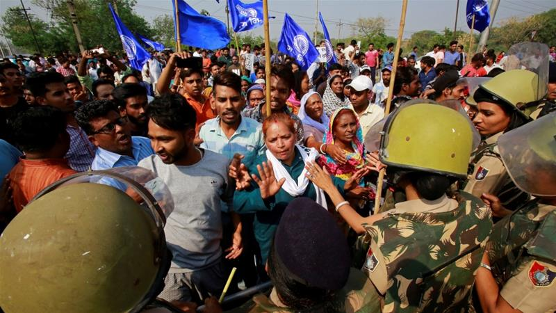Police try to stop people from the Dalit community as they take part in a protest during a nationwide strike called by Dalit organisations, in Chandigarh, India, April 2, 2018 [Ajay Verma/Reuters]