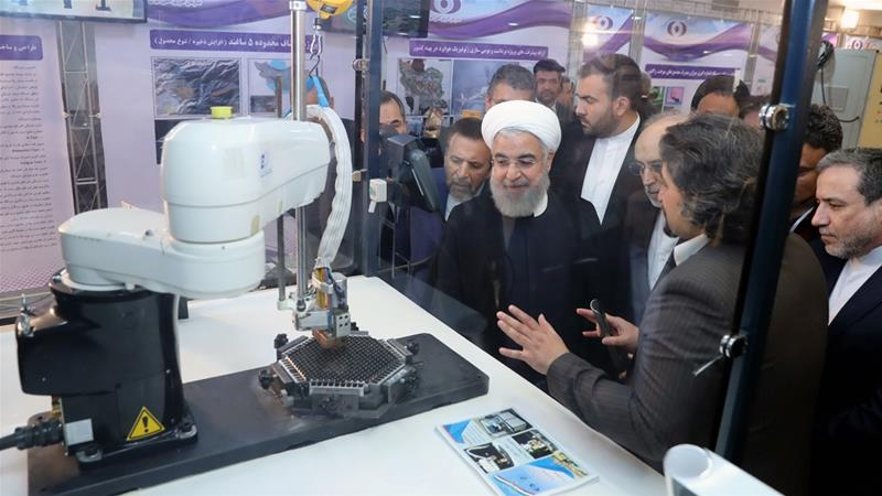 Iranian President Hassan Rouhani is shown at a ceremony to mark National Nuclear Technology Day in Tehran [Iranian presidency/AFP]