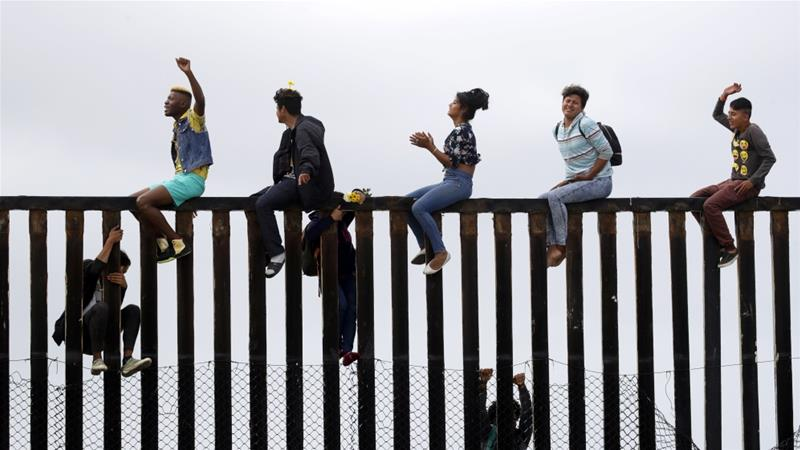 Immigrant advocates have vowed to stay at the border until asylum applications are accepted [Chris Carlson/AP Photo]