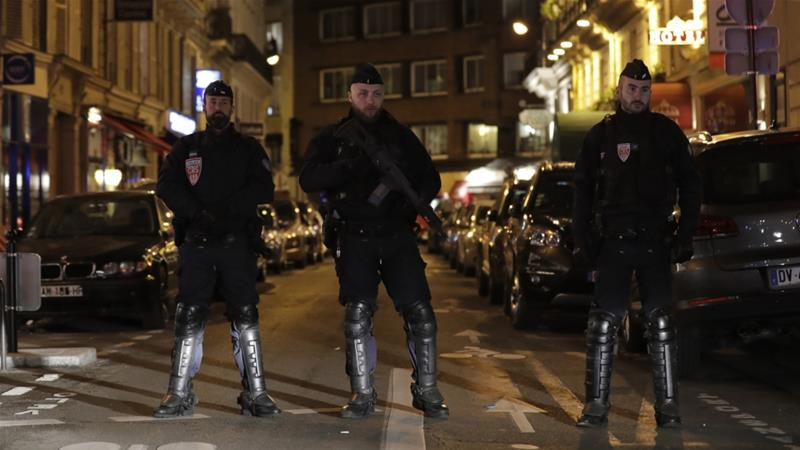 Police officers in Paris stand guard near the site of the attack [Thomas Samson/AFP]