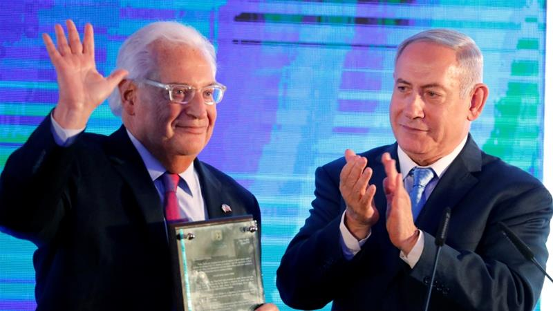 Netanyahu (R) hands US Ambassador to Israel David Friedman a letter of appreciation [Amir Cohen/Reuters]