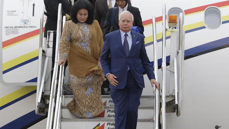 Najib and his wife, Rosmah, have been barred from leaving the country following his ouster [AP]