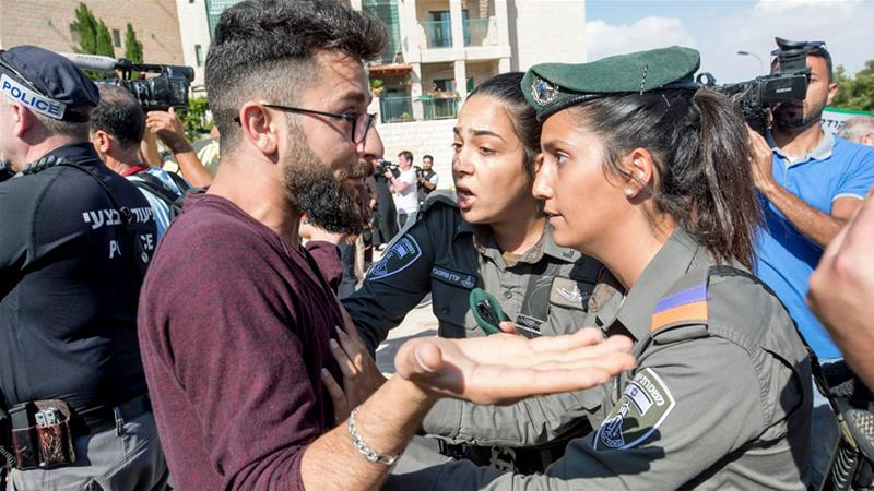 Israeli police argue with demonstrators during a protest outside of the US embassy in Jerusalem on Monday [Atef Safadi/EPA]