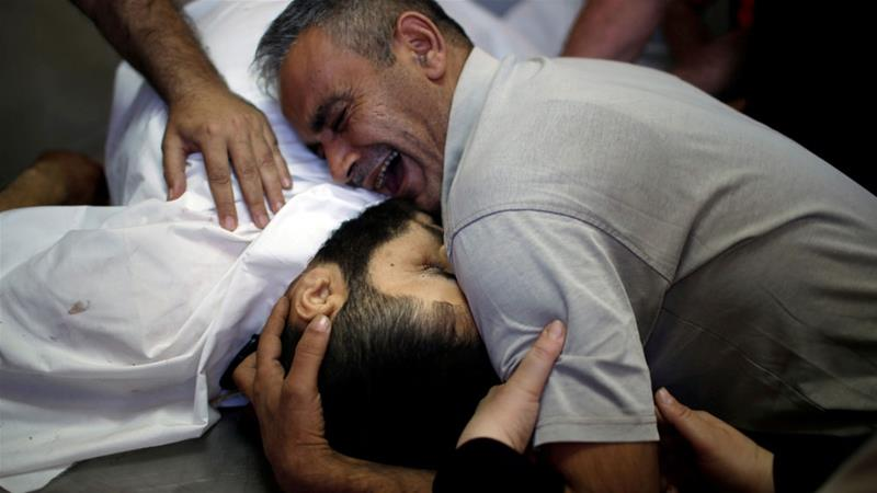 The brother of Palestinian Shaher al-Madhoon, who was killed during the protests, mourns at a hospital morgue in the northern Gaza Strip [Mohammed Salem/Reuters]