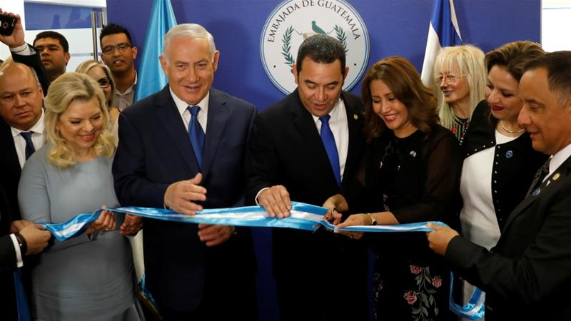 Hilda Patricia Marroquin, the wife of Guatemalan President Jimmy Morales, cuts the ribbon during the opening ceremony of the embassy of Guatemala in Jerusalem [Ronen Zvulun/Reuters]