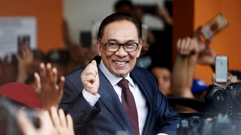 In 2015, Anwar was jailed for five years in what his supporters described as a politically motivated move to end his career [Reuters]