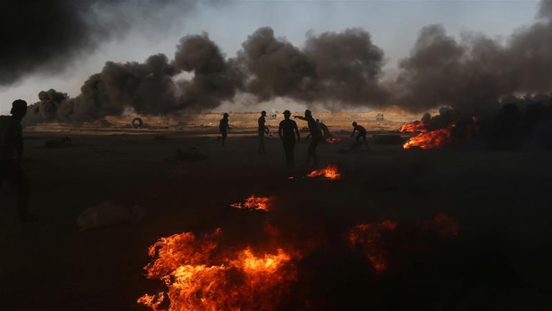 Palestinian demonstrators are seen during a protest marking the 70th anniversary of Nakba in the southern Gaza Strip May 15, 2018 [Ibraheem Abu Mustafa/Reuters]