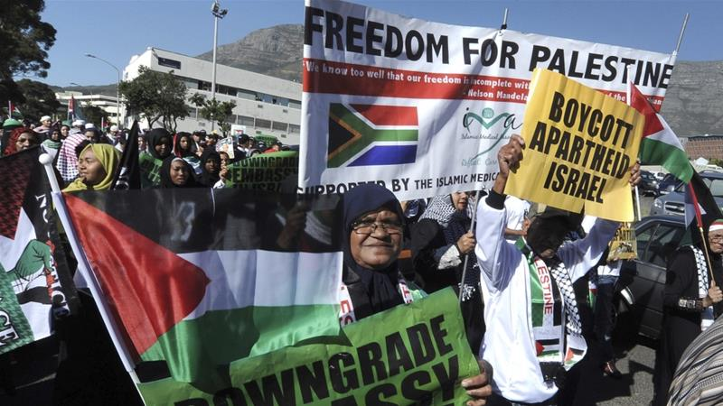 Protesters take part in a march to parliament in Cape Town on May 15 to protest against Israel's use of the deadly force against Palestinians invGaza [AP Photo/Nasief Manie]