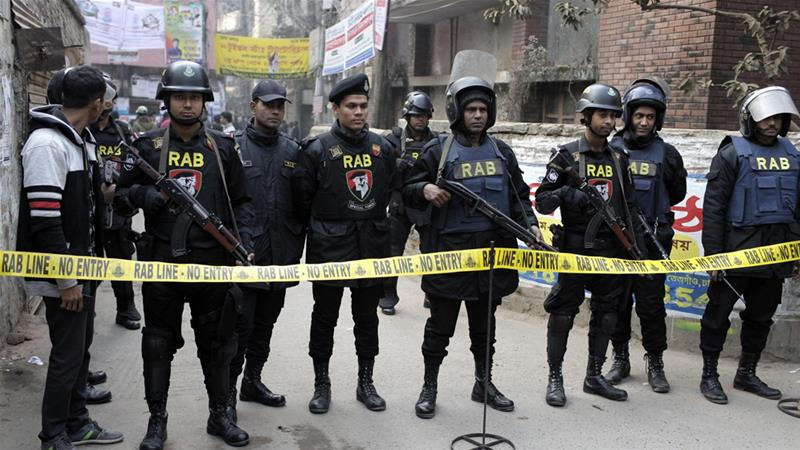 Members of the Rapid Action Battalion guard a street during an operation in Dhaka in January [File: AP]