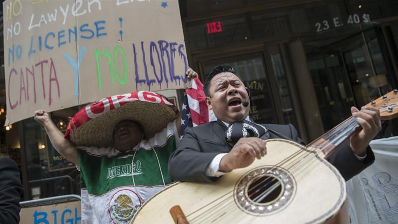 Protesters outside Schlossberg's office were accompanied by Mariachi bands singing in Spanish [Mary Altaffer/AP Photo]