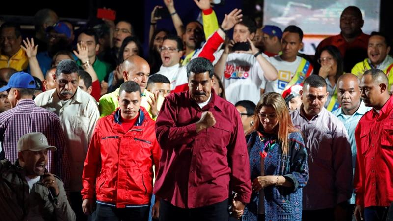 Venezuela's President Nicolas Maduro stands with supporters during a gathering after the results of the election were released, in Caracas, Venezuela [Carlos Garcia Rawlins/Reuters]