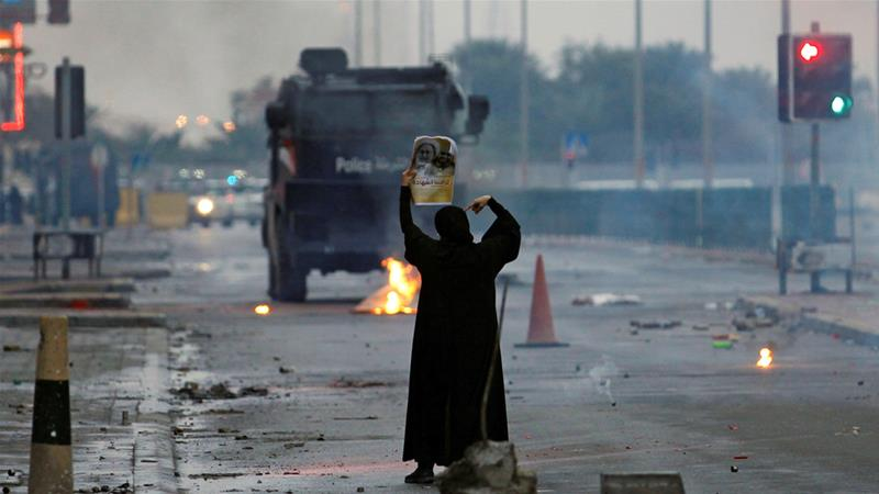 A protester confronts riot police in February 2017 [Hamad I Mohammed/Reuters]