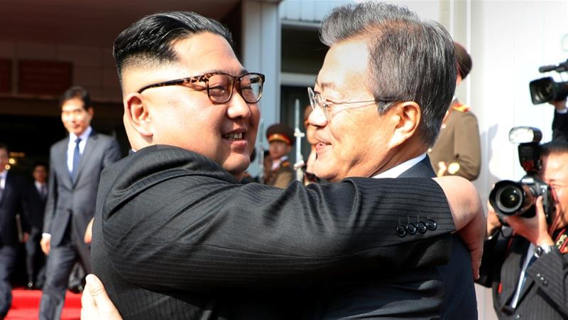 Moon Jae-in (R) and Kim met at the truce village of Panmunjom [The Presidential Blue House /Handout via Reuters]