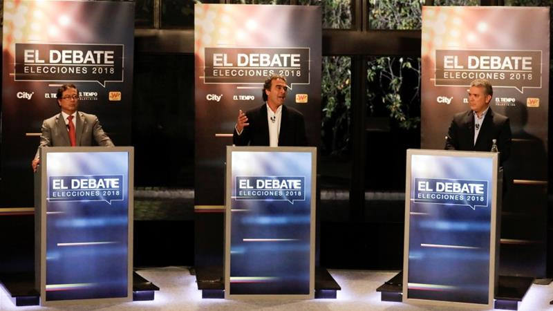 Colombian presidential candidates Gustavo Petro, Sergio Fajardo and Ivan Duque, take part in a presidential debate at El Tiempo newspaper in Bogota [Henry Romero/Reuters]