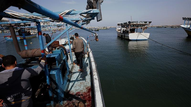 Israeli naval vessels have made it difficult for Gaza's fishermen to fish beyond a certain point, usually set at six nautical miles or about 11 km and have opened fire on Palestinians ships in the past [Mohammed Saber/EPA-EFE]