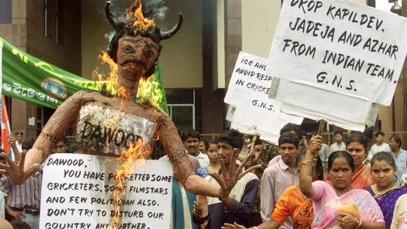 Activists burn an effigy of underworld don Dawood Ibrahim during a protest against the betting scandal involving some Indian cricketers in the eastern Indian city of Calcutta on May 29, 2000 [Reuters]