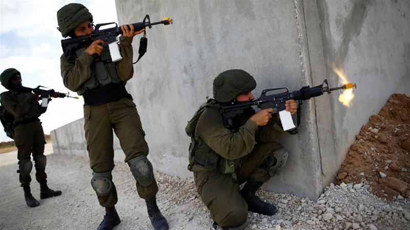 Israeli soldiers take part in an urban warfare drill inside a mock village at Tze'elim army base [File: Reuters]