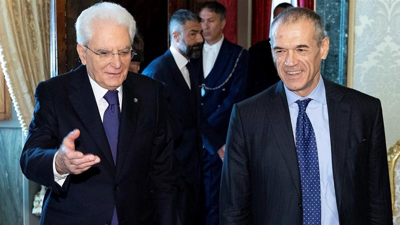 Cottarelli (right) said the election would be held in August if he failed to secure confidence votes now [Reuters]