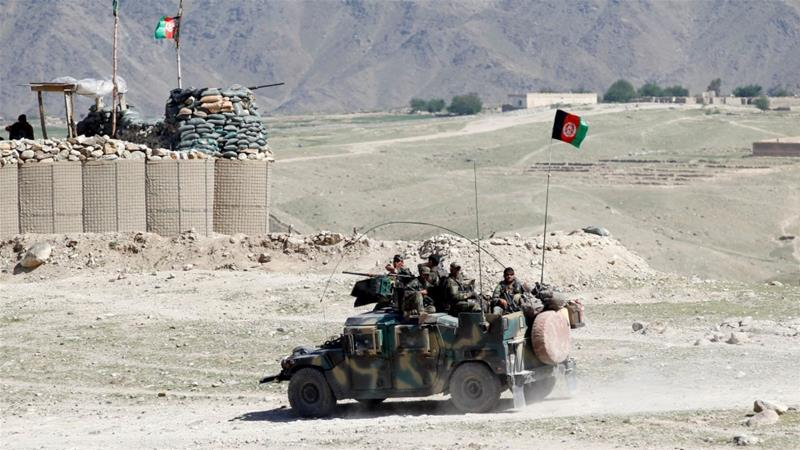 Taliban fighters try to take Afghan city, kill at least 14