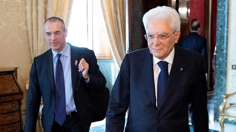 Carlo Cottarelli put on hold the formation of a technocrat government as 'new possibilities' reportedly emerged for agreement on an elected coalition [Italian Presidential Press Office/Reuters]