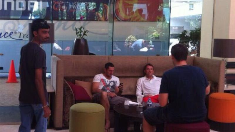 Aneel Munawar (left) in a hotel lobby in Sri Lanka at the same time as Graeme Swann and Tim Bresnan. There is no suggestion that the England stars knew Munawar or have done anything wrong [Images provided to Al Jazeera]